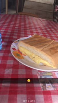 Pan Con Tortia in a street side cafe